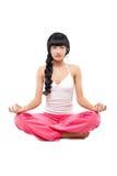 Woman in lotus pose Stock Image