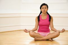 Woman in lotus pose Stock Image