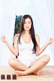 Woman in lotus pose at meditation. Woman with closed eyes in lotus pose at meditation Stock Images