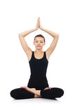 Woman in lotus pose Royalty Free Stock Photography
