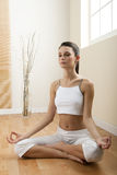 Woman in lotus position. Young woman meditating sitting in lotus position Royalty Free Stock Image