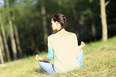 Woman in a lotus position Stock Image