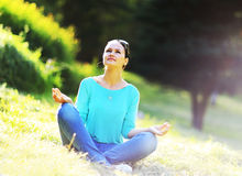 Woman in a lotus position Royalty Free Stock Image