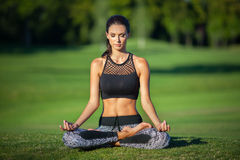 Woman in lotus position Royalty Free Stock Photo
