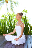 Woman in lotus position meditating Stock Photos