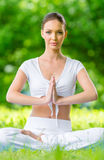 Woman in lotus position prayer gesturing Stock Image