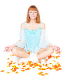 Woman in lotus position sitting on the floor Stock Image