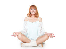 Woman in lotus position sitting on the floor Royalty Free Stock Photography