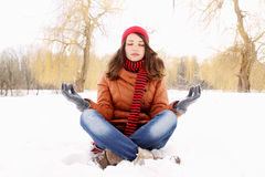Woman in a lotus position Stock Photography