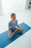 Woman in lotus position Royalty Free Stock Photography