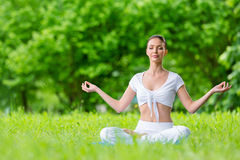 Woman in lotus position zen gesturing Stock Photography