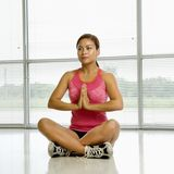 Woman in lotus posture. Stock Photography
