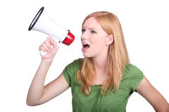 Woman with a loudspeaker. Young woman with a loudspeaker royalty free stock photography
