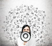 Woman with loudspeaker Stock Photography