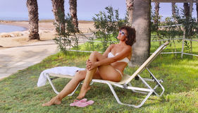 A woman in a lounge chair stock photo