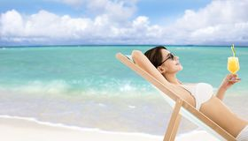 Woman in lounge chair with cocktail royalty free stock photos