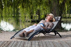 Woman in a lounge chair Royalty Free Stock Image