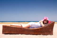 Woman on the lounger Royalty Free Stock Photo