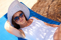 Woman on a lounger Stock Images