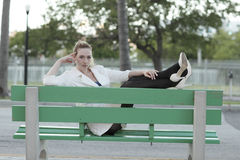Woman lounging on a bus bench Royalty Free Stock Photography