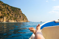Woman lounging on a catamaran sailboat Stock Image