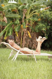 Woman lounging in the tropics Royalty Free Stock Images
