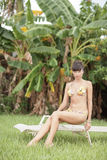 Woman lounging in the tropics Royalty Free Stock Photos