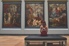 Woman at Louvre museum, Paris, France Stock Images