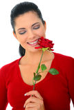 Woman In Love. Attractive woman smelling red rose smiling. isolated on white royalty free stock images