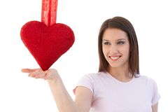 Woman in love balancing with red heart Royalty Free Stock Photography