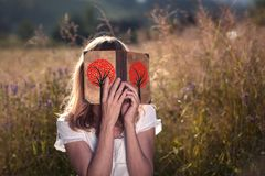 Blonde female with love book Royalty Free Stock Image