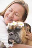 Woman in love with boxer pet dog. Portrait Woman in blurred background with boxer dog pet friend cuddling, showing love and affection, friendship and happiness Royalty Free Stock Photography