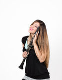 Woman in love with clarinet Stock Photography