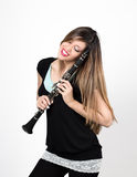 Woman in love with clarinet Royalty Free Stock Image
