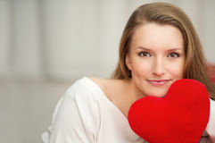 Woman in love with heart in hand - portrait for Valentines Day. Young woman in love with heart in hand - portrait for Valentines Day Stock Photo