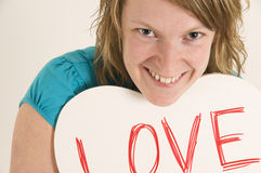 Woman with love heart sign Stock Photos