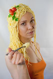 Woman in love with pasta. With spagetti hair Royalty Free Stock Photo