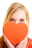 Woman in love with red heart Royalty Free Stock Photos