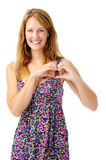 Woman in love shows heart with her hands Stock Photos