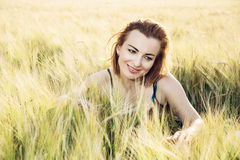 Woman in love is smoothing the wheat cobs Royalty Free Stock Images
