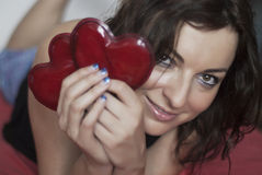 Woman in love with two red hearts Stock Images