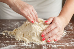 Woman with lovely hands making home-made buttermilk biscuits usi Royalty Free Stock Image