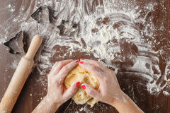 Woman with lovely hands making home-made buttermilk biscuits usi Royalty Free Stock Images