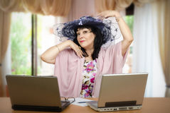 A woman loves being online matchmaker Stock Photos