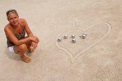 Woman loves jeu de boule Stock Image