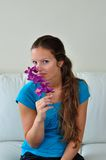 Woman loving flower Stock Images