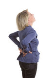Woman with low back pain. Besause of a pulled muscle, isolated, copy space Stock Photo