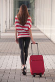 Woman with luggage. Woman pulling her luggage on the street royalty free stock photos