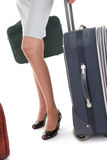 Woman  with a luggage. Business woman  with a luggage on white background Royalty Free Stock Images