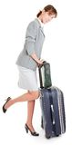 Woman  with a luggage. Business woman  with a luggage on white background Stock Photo